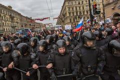 Police officers in riot gear block an Nevsky prospect