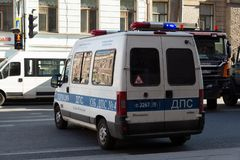 Russian police patrol car on the street. St. Petersburg, Russia - May 01, 2019:Russian patrol police car on the street of St. Petersburg with the flashing lights royalty free stock photos