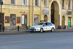 Russian police patrol car on the empty street. St. Petersburg, Russia - May 01, 2019: Russian police patrol car on the street of St. Petersburg, Liteiny prospect royalty free stock image
