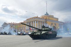 Russian T-72B3 tank against the background of the Admiralty building. Fragment of the military parade in honor of the Victory Day Stock Photos