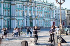 Street musicians perform for tourists and tips royalty free stock images