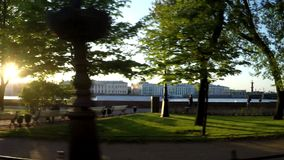 St. Petersburg, Russia-27 of May, 2015: A view from the car moving on The English Embankment on The Kunstkamera through. Bolshaya Neva River in Central Saint stock video footage