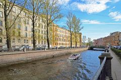 A white boat sails on the Canal in the spring in Saint-Petersbur Stock Photo