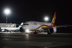 Night work at Pulkovo International Airport. St. Petersburg, Russia - November 22, 2017: Pulkovo International Airport. Airfield. HAinan Airlines company.In the royalty free stock photos