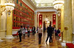 Interior of Hermitage Palace in St Petersburg. St Petersburg, Russia - Oct 8, 2016. People visit the Hermitage Winter Palace in Saint Petersburg, Russia Stock Image