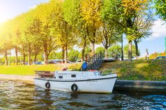 St Petersburg - Moika river embankment and autumn trees in sunny day in St Petersburg, Russia. St Petersburg, Russia- October 3, 2016. Autumn landscape of St Royalty Free Stock Photo