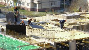 Construction workers install construction formwork, time lapse