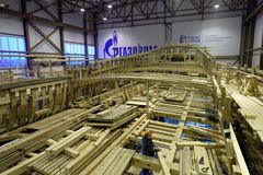 Workers in historical shipyard. St. Petersburg, Russia - October 27, 2016: People working on reconstruction of the first Russian ship of the line Poltava in the Royalty Free Stock Photos
