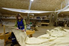 Sailmaker at work. St. Petersburg, Russia - October 27, 2016: Sailmaker Natalia Levit demonstrate the technics of producing sails for the first Russian ship of Royalty Free Stock Photos