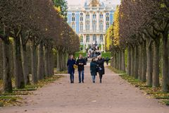 Walk on avenues of Catherine Park. Tsarskoye Selo. ST. PETERSBURG, RUSSIA - OCTOBER 17, 2017: Walk on avenues of Catherine Park. Tsarskoye Selo Royalty Free Stock Images
