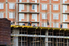 St.Petersburg. Russia -October 23,2018 : Workers are building a multi-storey house royalty free stock photo