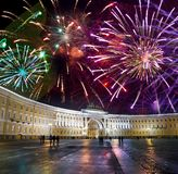 St. Petersburg. Russia. Palace Square and Arch of the General Staff Building in night illumination and Christmas fireworks.  stock photography