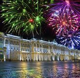 St. Petersburg. Russia. Palace Square and the Winter Palace in night illumination and Christmas fireworks.  royalty free stock photo