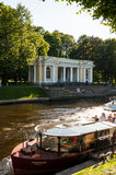 St Petersburg, Russia -Rossi Pavilion in the Michael Garden and the Moika river with pleasure boats. ST PETERSBURG, RUSSIA - AUGUST 15, 2017. Rossi Pavilion in Stock Image