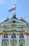 ST. PETERSBURG, RUSSIA.The Russian flag flutters over the Hermitage Stock Photo
