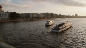 ST PETERSBURG, RUSSIA - 25 Sep 2016. River busses on river Neva in front of city architecture soft sunset light stock video