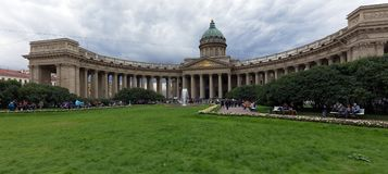 Kazan Cathedral in Saint Petersburg, Russia. St. Petersburg, Russia - September 8, 2017: People resting in front of Kazan Cathedral. The temple was built in 1801 Royalty Free Stock Images