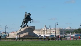 The Peter Great statue Horseman and tourists. ST PETERSBURG, RUSSIA - SEPTEMBER 4, 2017: The Peter Great statue Horseman and tourists Royalty Free Stock Images