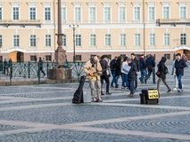 St. Petersburg, Russia - September 21, 2017: Street musician plays the guitar. Palace Square. Saint-Petersburg, Russia. Royalty Free Stock Photography