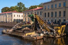 St. Petersburg, Russia - September 24, 2017: Work to deepen the bottom in the channel of the urban river Moika. Dredging machine raises the river bed Stock Image
