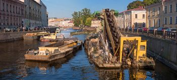 St. Petersburg, Russia - September 24, 2017: Work to deepen the bottom in the channel of the urban river Moika. Dredging machine raises the river bed Royalty Free Stock Images