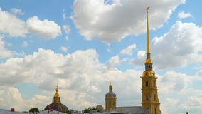 Towers of the Peter and Paul Fortress against a background of white clouds stock video footage
