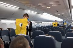 Safety briefing on board an aircraft Stock Images