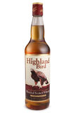 ST PETERSBURG RYSSLAND - December 12, 2015: Flaska av den höglands- fågeln, blandad skotsk whisky, Skottland Arkivfoto