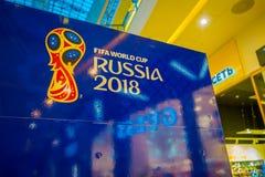 ST PETERSBURG RYSSLAND, 02 MAJ 2018: Den officiella logoFIFA världscupen 2018 i Ryssland skrivev ut på en blå bakgrund, inom av Royaltyfria Bilder