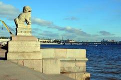 ST. PETERSBURG, SCULPTURES SHIH TZU. St. Petersburg, Russia.  Chinese (Manchurian) sculptures Shih Tzu on Petrovskaya quay of  Neva river Royalty Free Stock Image