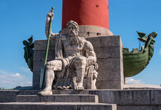 St. Petersburg. South rostral column. The male figure allegorically represents the Dnieper River. Earlier rostral column represented the Navy and served as a Royalty Free Stock Photo