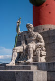 St. Petersburg. South rostral column. The male figure allegorically represents the Dnieper River. Earlier rostral column represented the Navy and served as a Royalty Free Stock Images