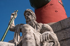 St. Petersburg. South rostral column. The male figure allegorically represents the Dnieper River. Fragment. Earlier rostral column represented the Navy and Royalty Free Stock Image