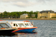 St. Petersburg, Tour boats at the pier   Royalty Free Stock Images