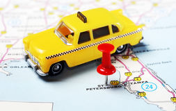 St. Petersburg USA Florida map taxi. Close up of St Petersburg Florida USA map with red pin and taxi car - Travel concept royalty free stock photos