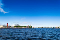St. Petersburg. View of the spit of Vasilievsky island. St. Petersburg view on Neva river. View of the spit of Vasilievsky island and rostralnie columns. Blue stock photo