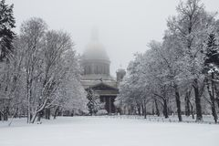 Saint Isaac`s cathedral in St. Petersburg, Russia on a snowy winters day. St. Petersburg in winter. Saint Isaac Cathedral in Saint Petersburg, Russia Stock Photography