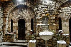 St. Petka church well and candle place in winter Royalty Free Stock Photography
