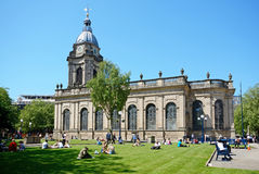 St Philips Cathedral, Birmingham. View of St Philips Cathedral with people relaxing in the Summer sunshine in the foreground, Birmingham, England, UK, Western Stock Photography