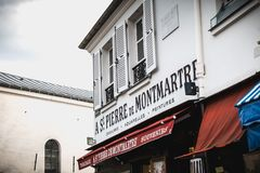 St Pierre de Montmartre painting canvas storefront on the Place royalty free stock photography
