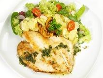 St. Pierre Fish with Potato Salad. On white Background stock photo