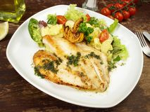 St. Pierre Fish with Potato Salad. On a wooden Board stock photos