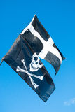 St Piran and Pirate flags together. Royalty Free Stock Photos