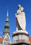 St. Roland Statue and St. Peter's Church in Riga Stock Photos