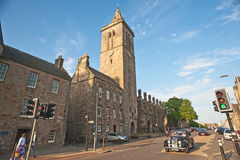 St Salvator's College and chapel. St Salvator's College tower and chapel, North Street, St  Andrews, Fife, Scotland with vintage Riley approaching traffic lights Stock Photography