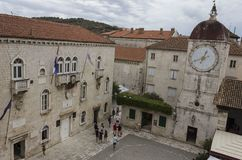 St. Sebastian`s Church and the Town Clock Tower in the ancient square of Trogir, Croatia stock photography