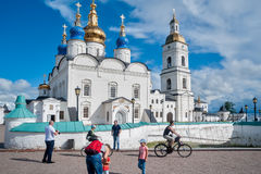 St Sophia-Assumption Cathedral in Tobolsk Kremlin. Tobolsk, Russia - July 15, 2016: Kremlin complex. Group of tourists near St Sophia-Assumption Cathedral and Stock Photos
