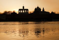 St. Sophia belfry at sunset. View from the opposite bank of the Volkhov River, Novgorod the Great stock photography