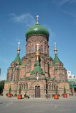 St. Sophia Cathedral of Harbin, China. St. Sophia Cathedral against backdrop of blue sky and white cloud stock images
