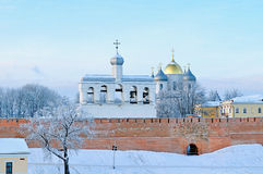 St. Sophia Cathedral in Veliky Novgorod, Russia - winter architectural landscape. St. Sophia Orthodox Cathedral with the belfry among the frosty trees in winter stock photos